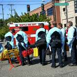 Medics wait to enter the scene after a shooting at Seattle Pacific University on Thursday, June 5, 2014. A man that shot students was disarmed by others at the scene.
