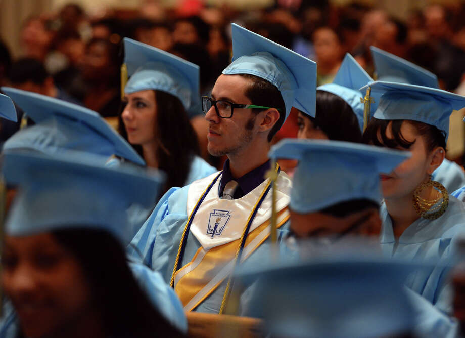 Graduate Spencer Martin, during Kolbe Cathedral's Class of 2014 Commencement Exercises at St. Augustine Cathedral in Bridgeport, Conn. on Thursday June 5, 2014. Photo: Christian Abraham / Connecticut Post
