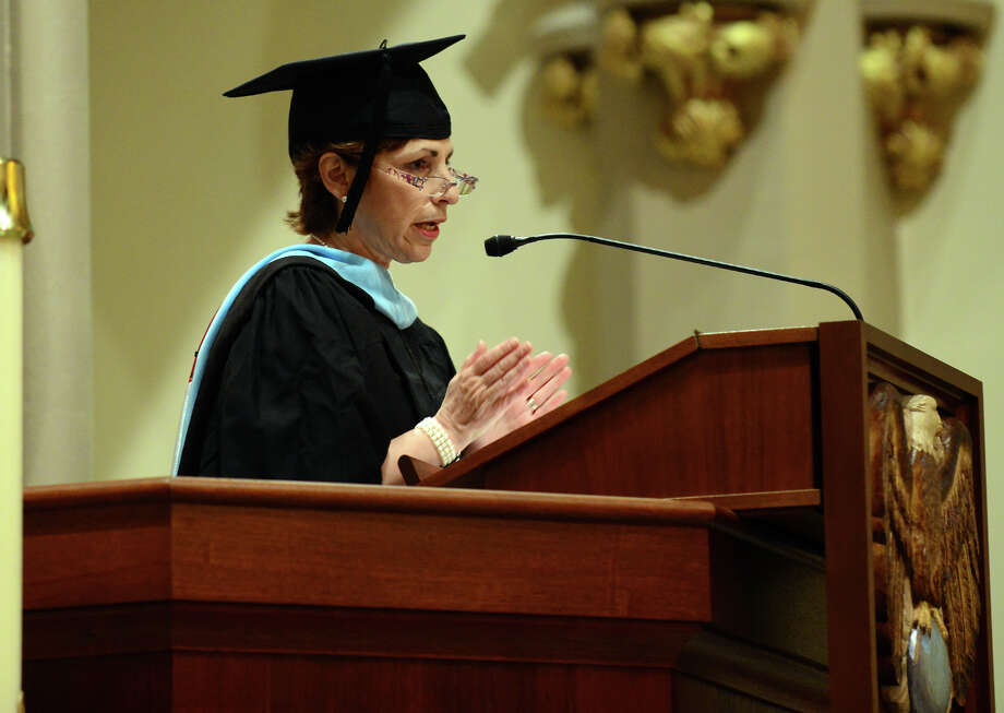 Lisa Matson presents the graduates, during Kolbe Cathedral's Class of 2014 Commencement Exercises at St. Augustine Cathedral in Bridgeport, Conn. on Thursday June 5, 2014. Photo: Christian Abraham / Connecticut Post