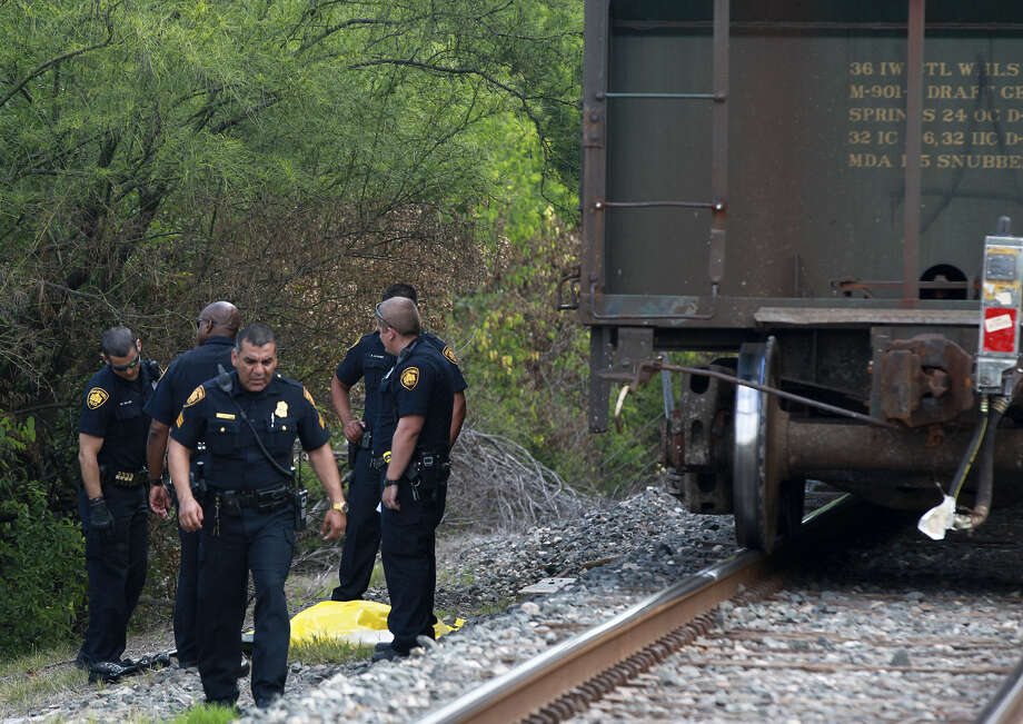 A Union Pacific freight train with horn blaring was unable to stop in time to avoid hitting a young man who was walking on the tracks along Empire Street near the San Antonio airport. Photo: John Davenport / San Antonio Express-News / ©San Antonio Express-News/John Davenport
