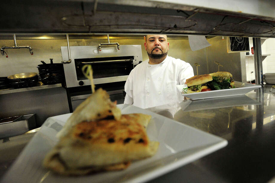 Executive Chef Juan Gonzalez works in the kitchen at Cask Republic in Stamford, Conn., on Thursday, June 5, 2014. Photo: Jason Rearick / Stamford Advocate