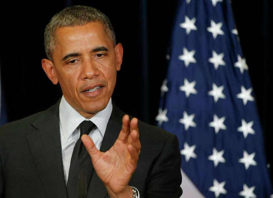 President Barack Obama says he has no role in the probe into French bank BNP Paribas. Photo: Charles Dharapak, STF / AP