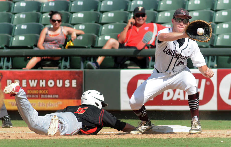 First baseman Will Gay, who scored George Ranch's only run, tries to make a defensive play on Victoria East's diving Tim Gleinser in the second inning. Photo: Jerry Baker, Freelance