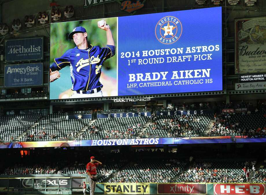 The Astros announce the selection of left-handed pitcher Brady Aiken, 17, as their first-round draft pick during their game against Angels at Minute Maid Park on Thursday night. Photo: Karen Waren / Houston Chronicle / © 2014 Houston Chronicle