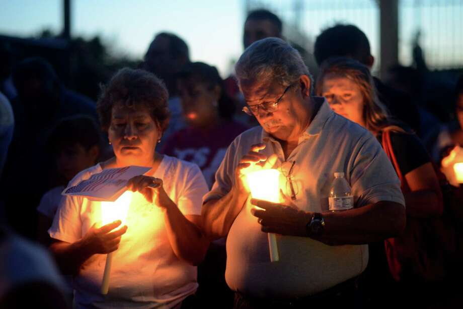 People participate in a candlelight vigil for Jeffrey Perez, an autistic boy who was hit and killed on Loop 410 this week, on Thursday, June 5, 2014. Photo: Billy Calzada, San Antonio Express-News /  San Antonio Express-News