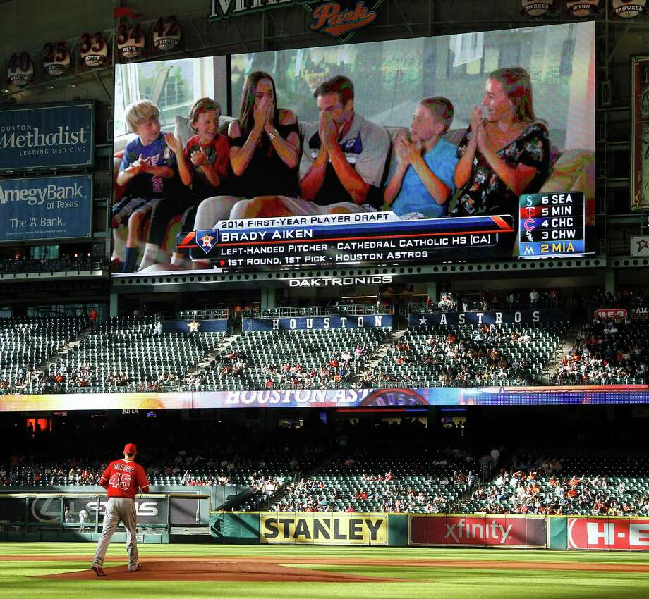 Brady Aiken makes his first appearance at Minute Maid Park as his reaction to being the No. 1 pick is broadcast during Thursday's game. Photo: Karen Warren, Staff / © 2014 Houston Chronicle