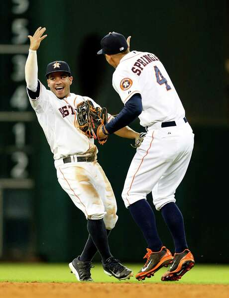 Second baseman Jose Altuve, left, and right fielder George Springer had a hand in the win over the Angels, combining for five of the Astros' eight RBIs. Photo: Karen Warren, Staff / © 2014 Houston Chronicle