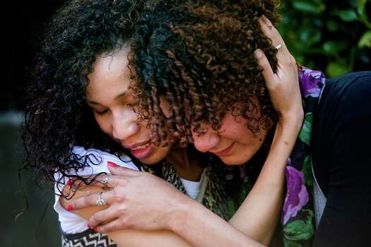 Following the lift of a lockdown in the wake of a school shooting, Seattle Pacific University faculty members Caenisha Warren, left, and Tanisha Hanson, right, embrace each other Thursday, June 5, 2014, on the campus of Seattle Pacific University in Seattle, Wash. A gunman fatally wounded one young man and seriously injured a 20-year-old woman before being disarmed by a student worker at the small college. Three men and one woman were injured in the shooting, which started at 3:25 p.m. on SPU's Queen Anne neighborhood campus. One of the victims, a man in his 20s, died after being rushed to a hospital. Photo: JORDAN STEAD, SEATTLEPI.COM / SEATTLEPI.COM