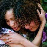 Following the lift of a lockdown in the wake of a school shooting, Seattle Pacific University faculty members Caenisha Warren, left, and Tanisha Hanson, right, embrace each other Thursday, June 5, 2014, on the campus of Seattle Pacific University in Seattle, Wash. A gunman fatally wounded one young man and seriously injured a 20-year-old woman before being disarmed by a student worker at the small college. Three men and one woman were injured in the shooting, which started at 3:25 p.m. on SPU's Queen Anne neighborhood campus. One of the victims, a man in his 20s, died after being rushed to a hospital.