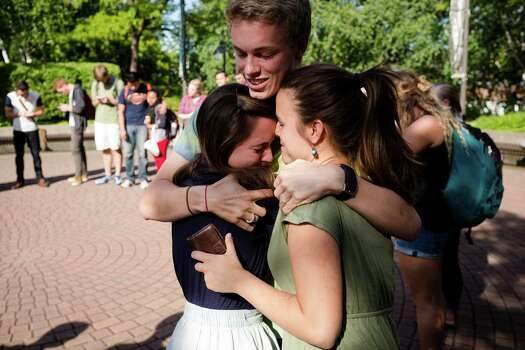 Following the lift of a lockdown in the wake of a school shooting, Caleb Gustin, 19, center, hugs friends after reuniting Thursday, June 5, 2014, on the campus of Seattle Pacific University in Seattle, Wash. A gunman fatally wounded one young man and seriously injured a 20-year-old woman before being disarmed by a student worker at the small college. Three men and one woman were injured in the shooting, which started at 3:25 p.m. on SPU's Queen Anne neighborhood campus. One of the victims, a man in his 20s, died after being rushed to a hospital. Photo: JORDAN STEAD, SEATTLEPI.COM / SEATTLEPI.COM
