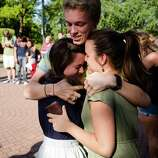 Following the lift of a lockdown in the wake of a school shooting, Caleb Gustin, 19, center, hugs friends after reuniting Thursday, June 5, 2014, on the campus of Seattle Pacific University in Seattle, Wash. A gunman fatally wounded one young man and seriously injured a 20-year-old woman before being disarmed by a student worker at the small college. Three men and one woman were injured in the shooting, which started at 3:25 p.m. on SPU's Queen Anne neighborhood campus. One of the victims, a man in his 20s, died after being rushed to a hospital.