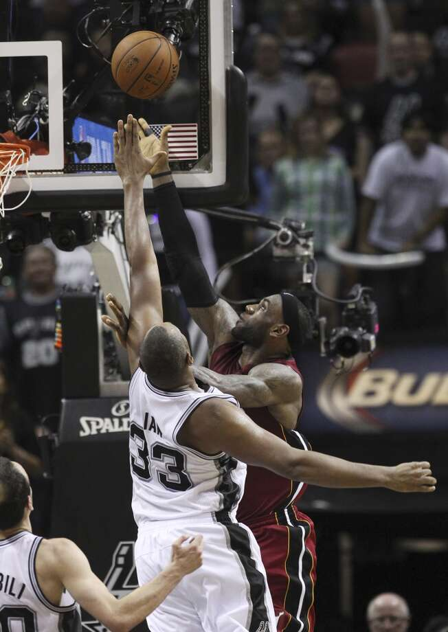 Miami Heat's LeBron James (06) goes up for a shot against Spurs' Boris Diaw (33) in the second half of Game 1 of the 2014 NBA Finals at the AT&T Center on Thursday, June 5, 2014. Spurs defeat the Heat, 110-95. (Kin Man Hui/San Antonio Express-News) Photo: Kin Man Hui, San Antonio Express-News