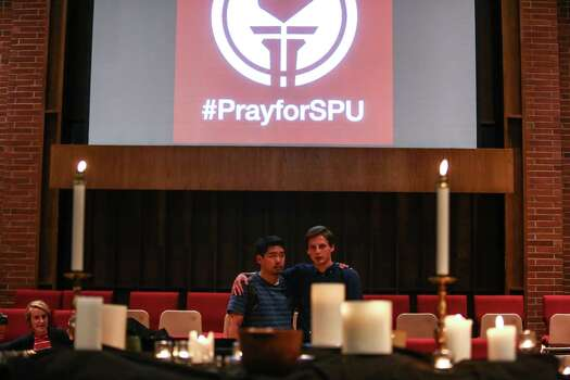 Students pray at the First Free Methodist Church after a shooting at Seattle Pacific University on Thursday, June 5, 2014. A man that shot students was disarmed by others at the scene. Photo: JOSHUA TRUJILLO, SEATTLEPI.COM / SEATTLEPI.COM
