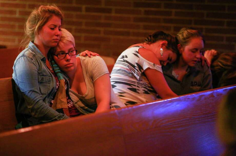 Annalyse Hurd, left, and Olivia Hutton, center, pray at the First Free Methodist Church after a shooting at Seattle Pacific University on Thursday, June 5, 2014. A man that shot students was disarmed by others at the scene. Photo: JOSHUA TRUJILLO, SEATTLEPI.COM / SEATTLEPI.COM