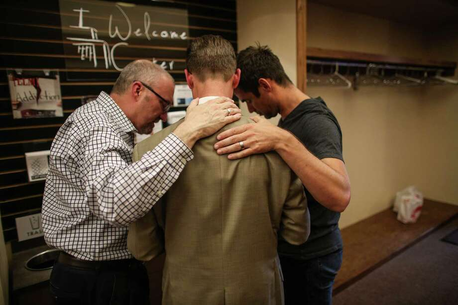 SPU President Dan Martin, center, prays with university trustee Matt Whitehead and Geoff Smith, right, in the Free Methodist church after a shooting at Seattle Pacific University on Thursday, June 5, 2014. A man that shot students was disarmed by others at the scene. Photo: JOSHUA TRUJILLO, SEATTLEPI.COM / SEATTLEPI.COM