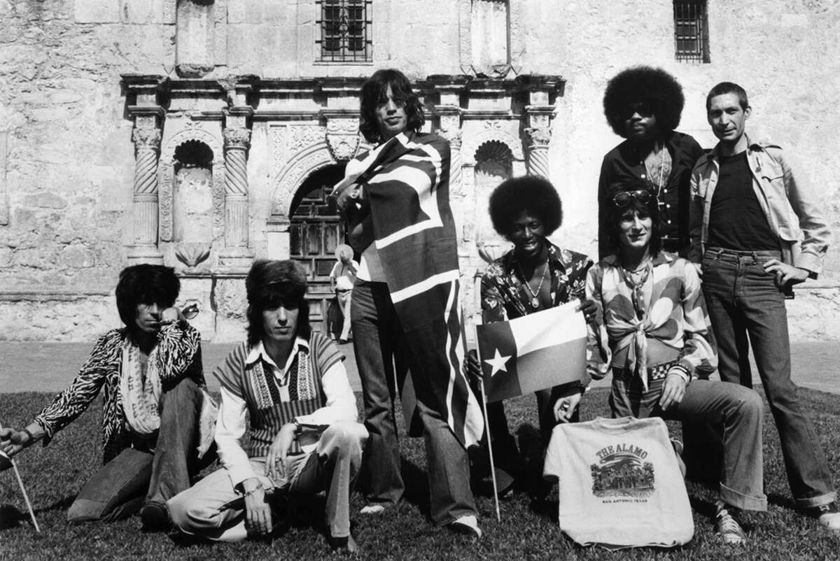 Photo of ROLLING STONES and Keith RICHARDS and Bill WYMAN and Mick JAGGER and Ollie BROWN and Ron WOOD and Billy PRESTON and Charlie WATTS, Posed group portrait at the Alamo - L-R Keith Richard, Billy Wyman, Mick Jagger, Ollie Brown, Ron Wood, Billy Preston and Charlie Watts