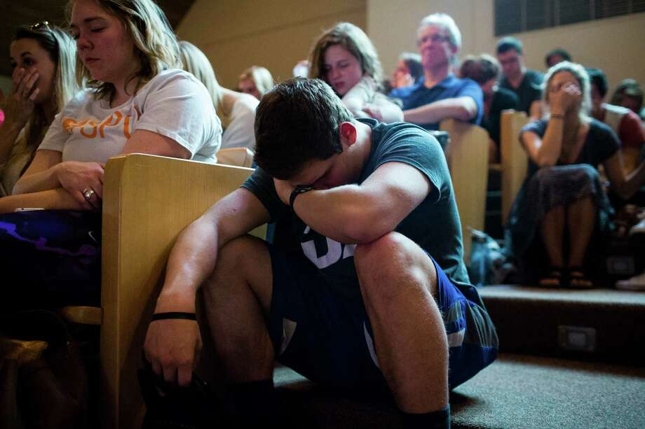 Seattle Pacific University students and faculty pray together at First Free Methodist Church following a campus shooting that left one dead and multiple injured Thursday, June 5, 2014, near Seattle Pacific University in Seattle, Wash. Photo: JORDAN STEAD, SEATTLEPI.COM / SEATTLEPI.COM
