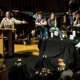 Seattle Pacific University students and faculty pray together at First Free Methodist Church following a campus shooting that left one dead and multiple injured Thursday, June 5, 2014, near Seattle Pacific University in Seattle, Wash.
