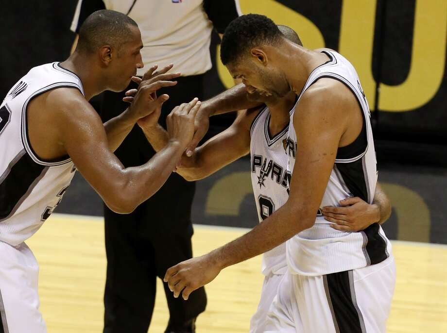 Game 1: Spurs 110, Heat 95 Spurs lead series 1-0  Tim Duncan, Boris Diaw and Tony Parker celebrate after defeating the Heat. Photo: Chris Covatta, Getty Images
