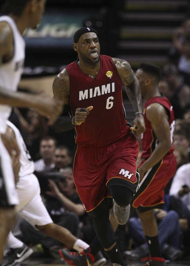 Miami Heat's LeBron James (06) runs up the floor after a score against the Spurs in the first quarter of Game 1 of the 2014 NBA Finals at the AT&T Center on Thursday, June 5, 2014. Photo: Kin Man Hui, San Antonio Express-News