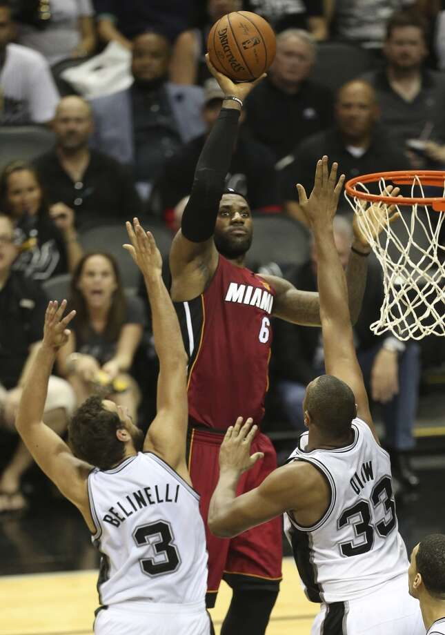 Miami Heat's LeBron James shoots over San Antonio Spurs' Marco Belinelli and Boris Diaw during the second half at the AT&T Center, Thursday, June 5, 2014. The Spurs won 110-95 to lead the series 1-0. Photo: Jerry Lara, San Antonio Express-News