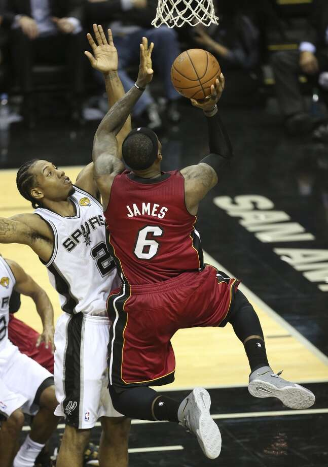 San Antonio Spurs' Kawhi Leonard puts pressure on Miami Heat's LeBron James during the second half of game one of the NBA Finals at the AT&T Center, Thursday, June 5, 2014. The Spurs won 110-95 to lead the series 1-0. Photo: Jerry Lara, San Antonio Express-News