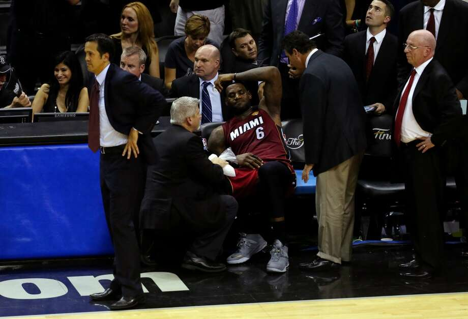 LeBron James  sits on the bench after leaving Game 1 in the fourth quarter with cramps. Photo: Chris Covatta, Getty Images