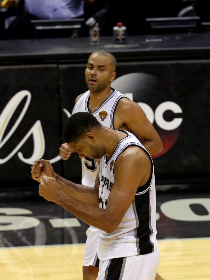 Tim Duncan and Tony Parker celebrate after winning Game 1. Photo: Chris Covatta, Getty Images