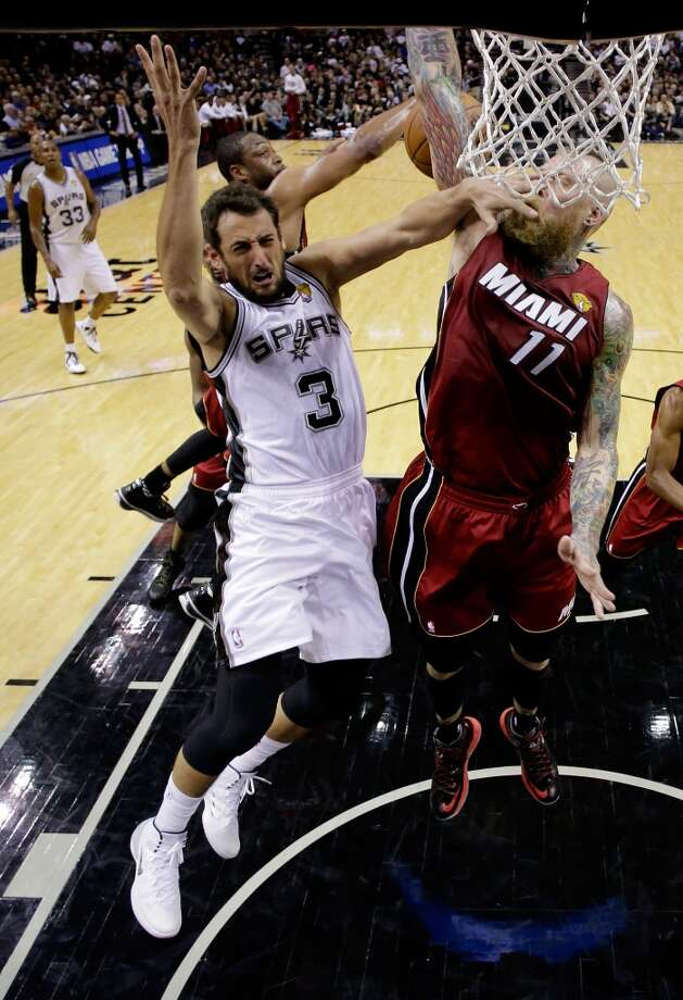 Marco Belinelli (3) goes to the basket against Chris Andersen. Photo: Pool, Getty Images
