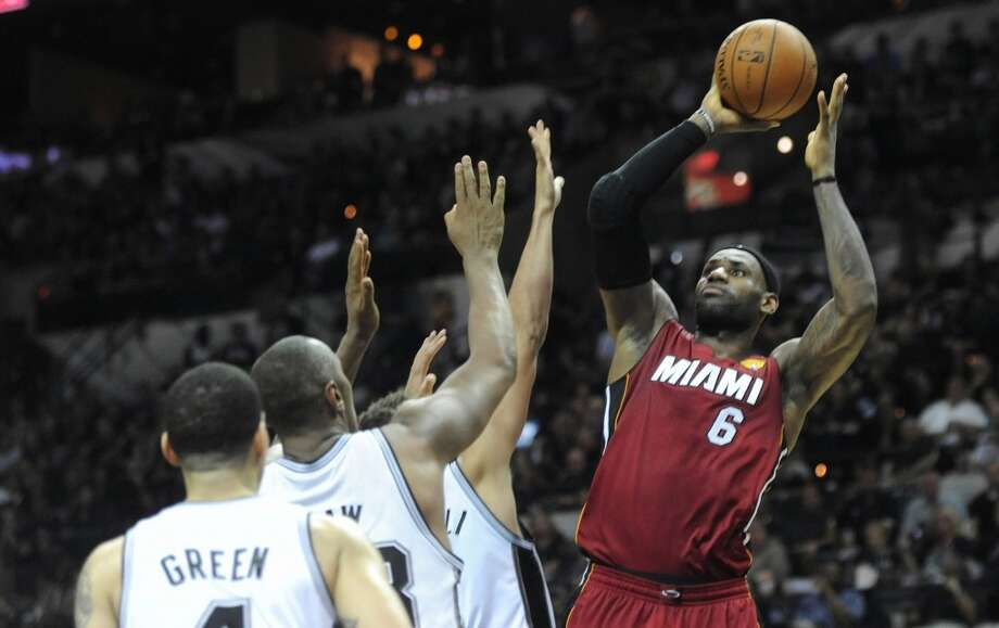 LeBron James scores against the during the third quarter in Game 1. Photo: Joe Cavaretta, McClatchy-Tribune News Service