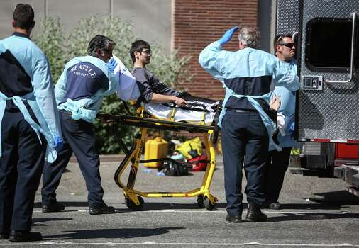 Jon Meis, who is credited with stopping the shooter by pepper spraying him and tackling him, is wheeled from the scene by medics after a shooting at Seattle Pacific University on Thursday, June 5, 2014. Photo: JOSHUA TRUJILLO, SEATTLEPI.COM / SEATTLEPI.COM