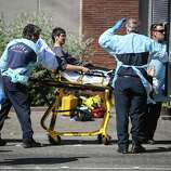 Jon Meis, who is credited with stopping the shooter by pepper spraying him and tackling him, is wheeled from the scene by medics after a shooting at Seattle Pacific University on Thursday, June 5, 2014.