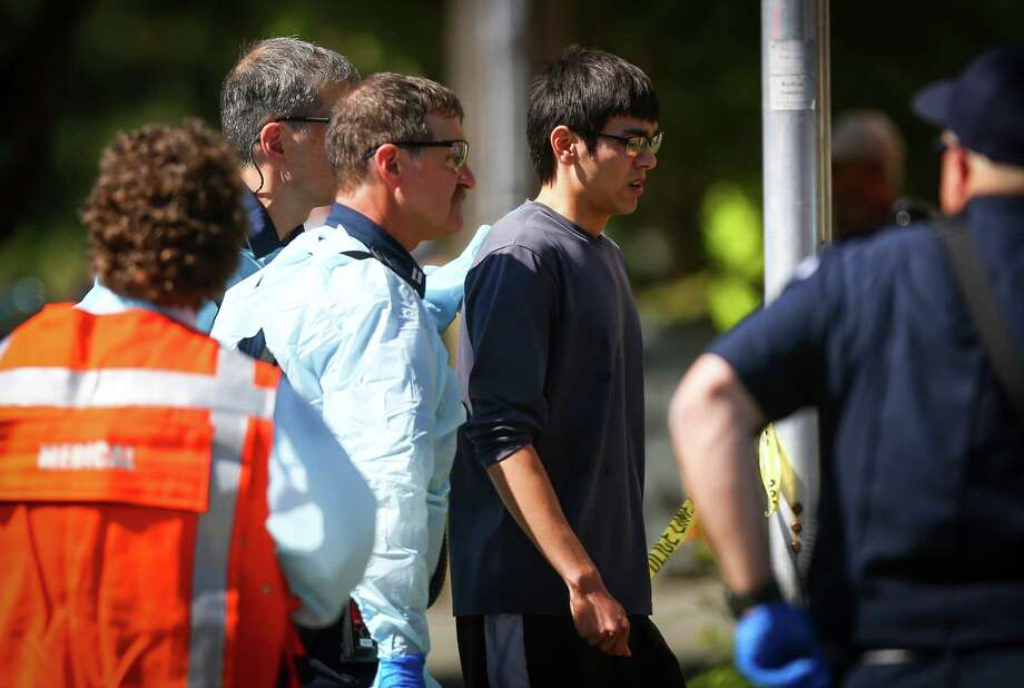Jon Meis, who is credited with stopping the shooter by pepper spraying him and tackling him, is taken from the scene by medics after a shooting at Seattle Pacific University on Thursday, June 5, 2014. Photo: JOSHUA TRUJILLO, SEATTLEPI.COM / SEATTLEPI.COM