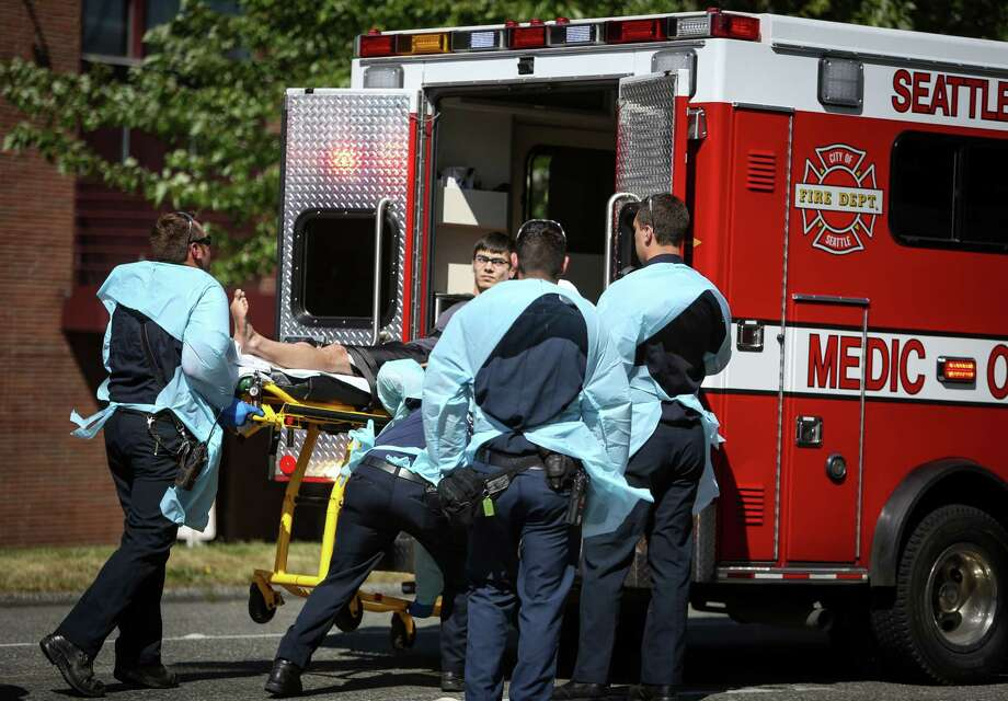 Jon Meis, who is credited with stopping the shooter by pepper spraying him and tackling him, is loaded into an ambulance by medics after a shooting at Seattle Pacific University on Thursday, June 5, 2014. Photo: JOSHUA TRUJILLO, SEATTLEPI.COM / SEATTLEPI.COM