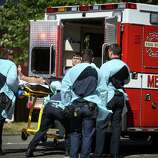 Jon Meis, who is credited with stopping the shooter by pepper spraying him and tackling him, is loaded into an ambulance by medics after a shooting at Seattle Pacific University on Thursday, June 5, 2014.