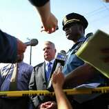 Seattle Police Chief Harry Bailey speaks alongside Mayor Ed Murray, center, after a shooting at Seattle Pacific University on Thursday, June 5, 2014.