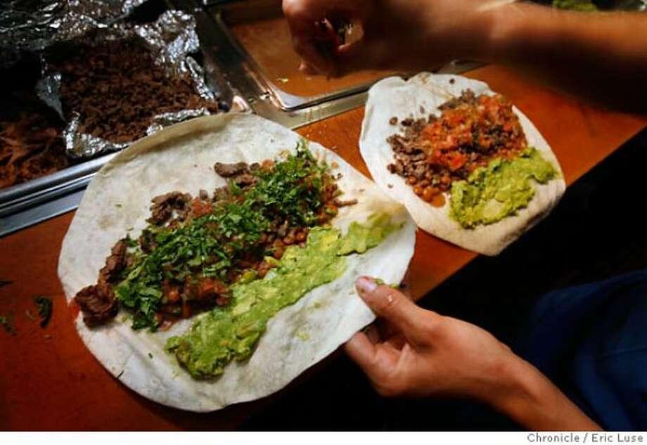 Eat a burrito at La Taqueria on Mission Street. Photo: Eric Luse / The Chronicle