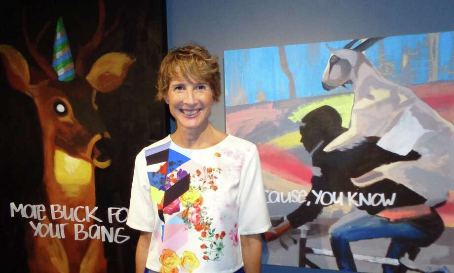 Westport artist Tammy Winser poses in front of her paintings at the first ever Pop-Up art show Thursday. Winser is one of five founding members of the Westport Artist Collective, which will hold a similar one-night-only exhibit at the Westport Arts Center in the fall. Photo: Meg Barone / Westport News