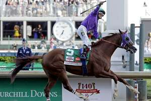 Victor Espinoza rides California Chrome to a victory during the 140th running of the Kentucky Derby horse race at Churchill Downs Saturday, May 3, 2014, in Louisville, Ky.