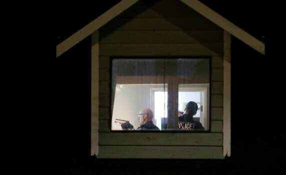 Police officers and detectives search a home believed to be tied to Aaron R. Ybarra, who was arrested Thursday, June 5, 2014 following a shooting at Seattle Pacific University in Seattle. Photo: Ted S. Warren, AP / AP