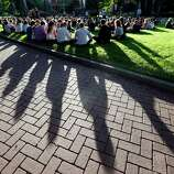 Students from Seattle Pacific University gather outside in a prayer circle after a nearby church service was full following a shooting on the campus of the university Thursday, June 5, 2014, in Seattle. A lone gunman armed with a shotgun and a knife opened fire in a building on the campus, killing one person before he was subdued with pepper spray by a student as he tried to reload, police said.