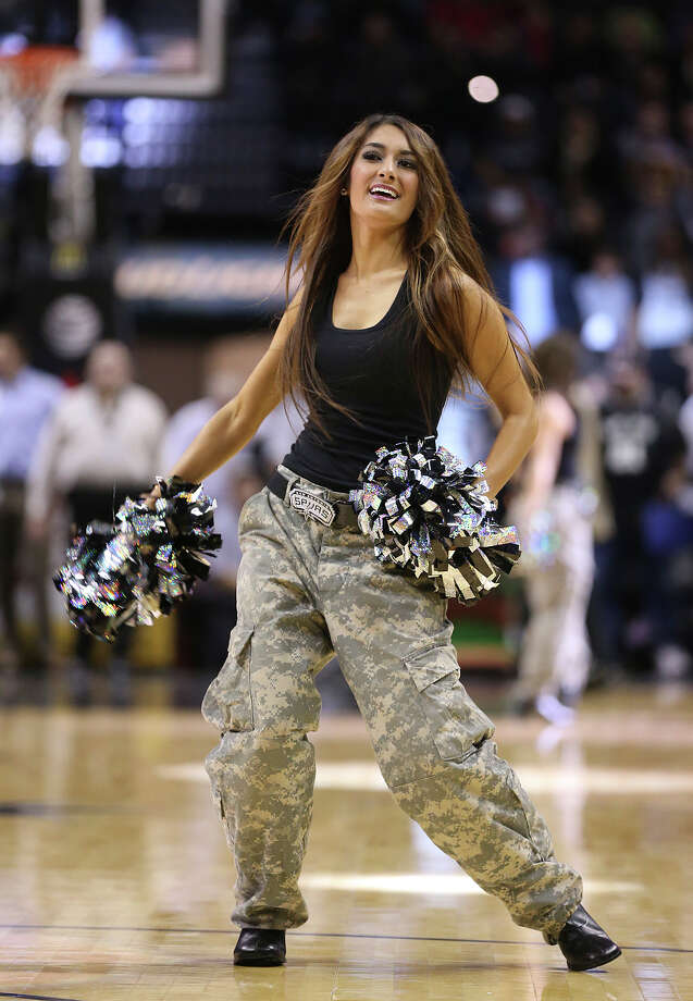 The San Antonio Spurs Silver Dancers wear military-inspired camouflage uniforms to honor the servicemen and women of the Armed Forces during their game against the Washington Wizards at the AT&T Center, Wednesday, Nov. 13, 2013. Photo: Jerry Lara, San Antonio Express-News / ©2013 San Antonio Express-News