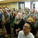 People stand in the foyer during a prayer service at the First Free Methodist Church Thursday, June 5, 2014 at Seattle Pacific University in Seattle, where a shooting took place Thursday afternoon.