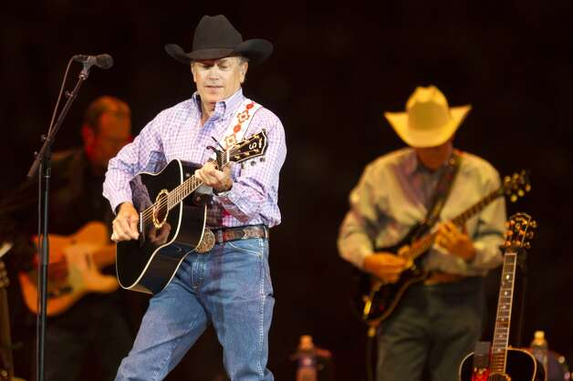 George Strait performs his set at Reliant Stadium during the final concert at the Houston Livestock Show and Rodeo Sunday, March 17, 2013, in Houston. ( Brett Coomer / Houston Chronicle ) Photo: Brett Coomer, Houston Chronicle