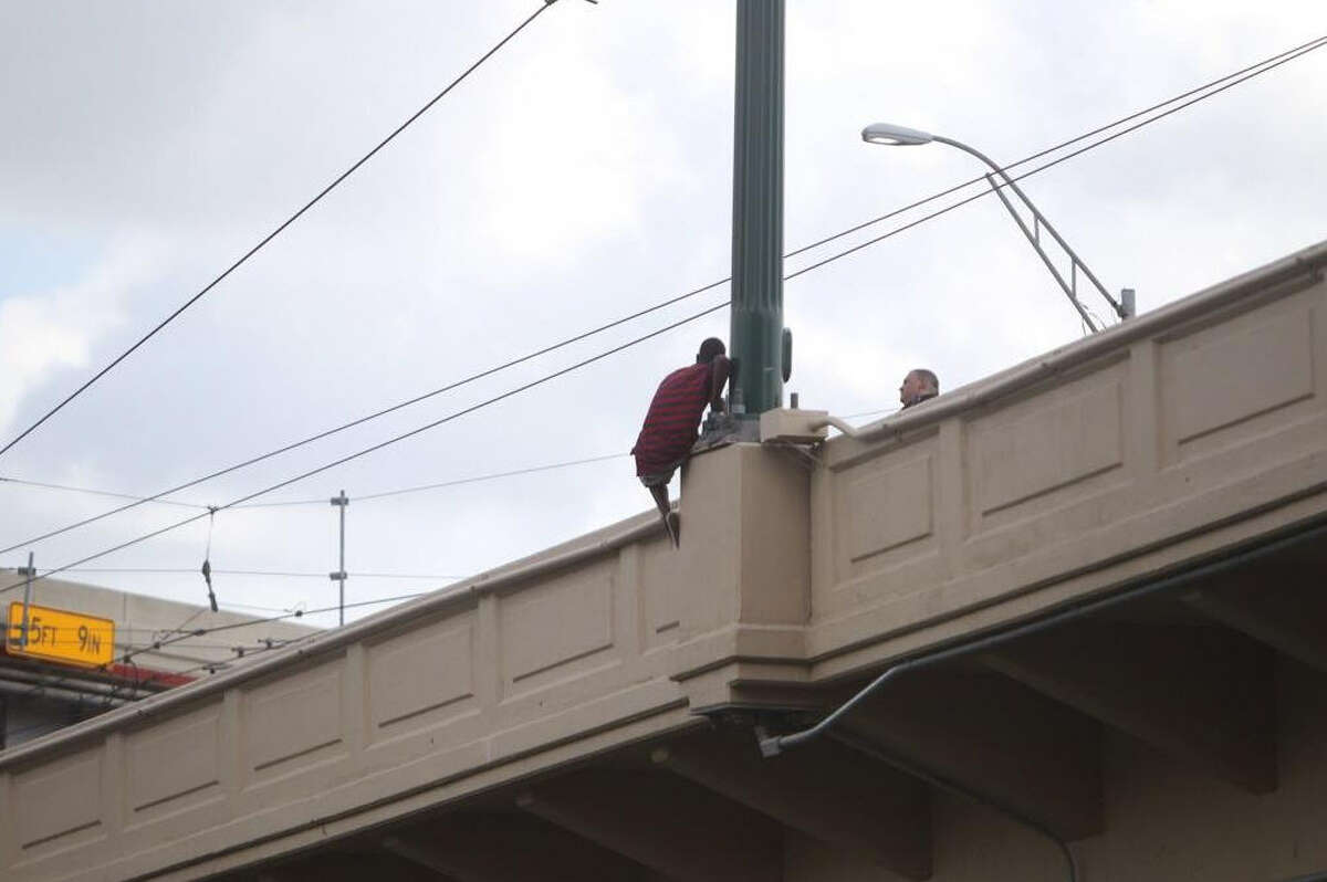 A possibly suicidal man was coaxed from a bridge spanning Buffalo Bayou near the University of Houston-Downtown campus Friday morning, officials said.
