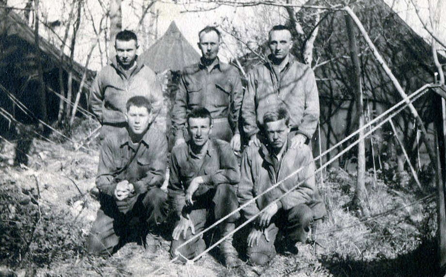 John Stephen Hines, standing far right -- the father of Fairfield Citizen columnist Patricia A. Hines -- photographed with his Army comrades in the 467th anti-aircraft artillery battalion somewhere in Europe in 1944. Photo: Contributed Photo / Fairfield Citizen