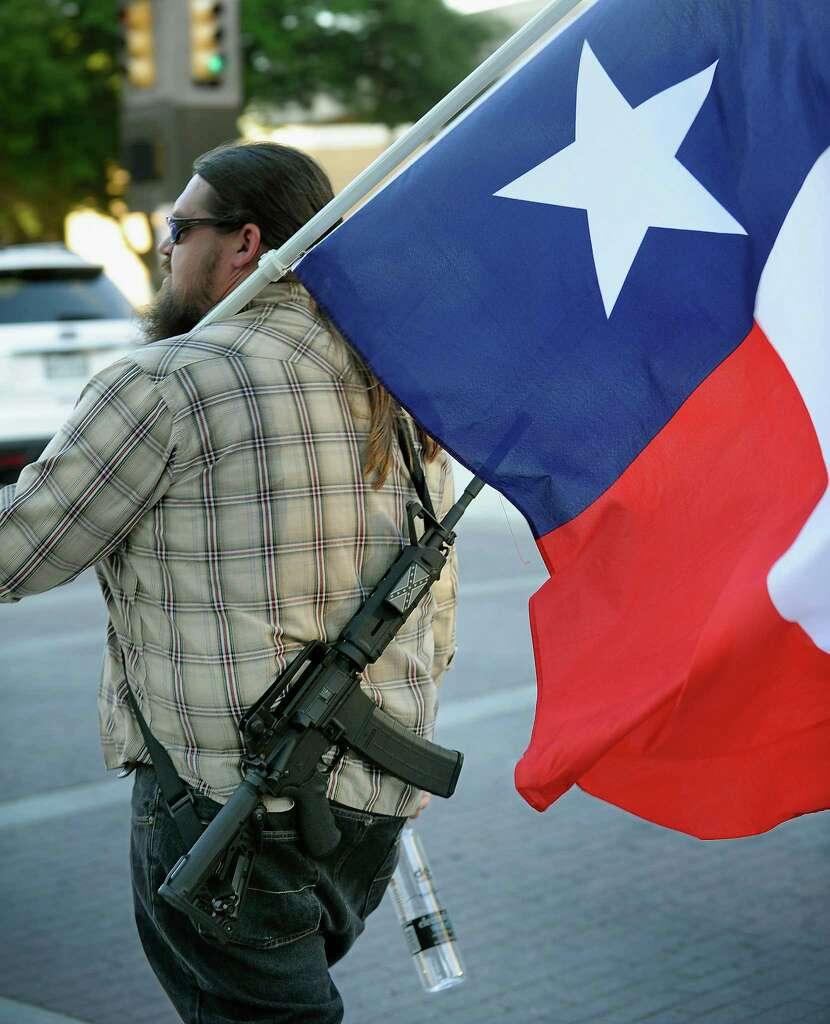 An openly carried handgun is of course permitted to be loaded and ready to fire. That's the whole reason behind the law, to be able to use it for defense purposes instantaneously. It would be best, though, for the safety mechanism to be on. (Sources: Open Carry Texas, The Texas Rifle Association, The Texas Restaurant Association, Texas Department of Public Safety, Central Texas Gun Works) Photo: Max Faulkner, Associated Press / Fort Worth Star-Telegarm