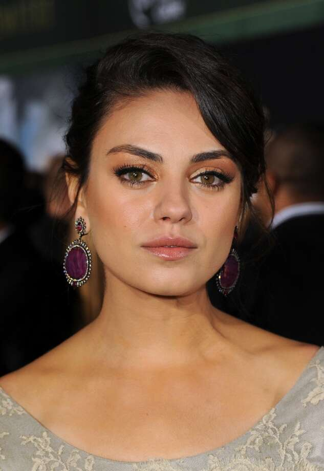 "Actress Mila Kunis arrives for the world premiere of Walt Disney Pictures' ""Oz The Great And Powerful"" on February 13, 2013 in Hollywood, California with what seems to be little more than a subtle glow, eye makeup and lip gloss. Photo: Kevin Winter, Getty Images"