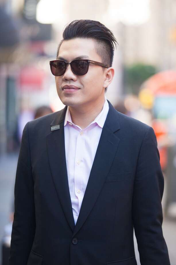 "Nguyen finds that dressing properly for work shows respect for his clients and colleagues. Or, as paraphrased Tom Ford (who designed his glasses), ""Dressing well is a form of good manners."" Photo: Anna-Alexia Basile"