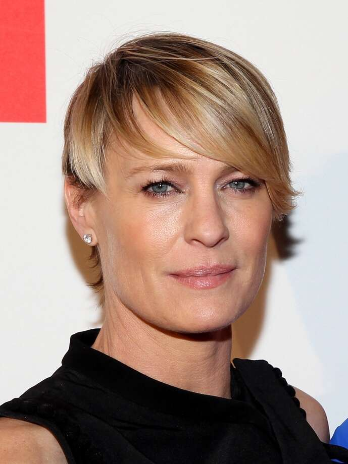 Actress Robin Wright with just the hint of eye makeup walks the red carpet at Google/Netflix White House Correspondent's Weekend Party on Friday, May 2, 2014 in Washington, DC. Photo: Paul Morigi, Getty Images For Netflix